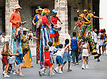 Street performers entertain a group of children on the streets of Havana, Cuba