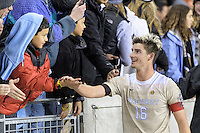 Houston, TX - Friday December 9, 2016: Ian Harkes (16) of the Wake Forest Demon Deacons high-fives a fan after his goal defeated the Denver Pioneers at the NCAA Men's Soccer Semifinals at BBVA Compass Stadium in Houston Texas.