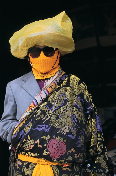 Tibetan man in rain gear, Sershul, Kham, Tibet, 2005