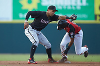 Kannapolis Intimidators shortstop Luis Curbelo (16) fields a throw as Bubba Thompson (25) of the Hickory Crawdads steals second base at L.P. Frans Stadium on July 20, 2018 in Hickory, North Carolina. The Crawdads defeated the Intimidators 4-1. (Brian Westerholt/Four Seam Images)