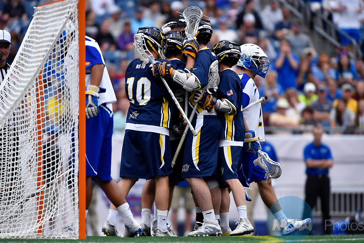 FOXBORO, MA - MAY 28: The Merrimack Warriors react after scoring a goal against the Limestone Saints during the Division II Men's Lacrosse Championship held at Gillette Stadium on May 28, 2017 in Foxboro, Massachusetts. (Photo by Larry French/NCAA Photos via Getty Images)