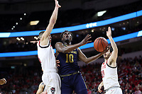RALEIGH, NC - JANUARY 9: T.J. Gibbs #10 of the University of Notre Dame drives the lane during a game between Notre Dame and NC State at PNC Arena on January 9, 2020 in Raleigh, North Carolina.