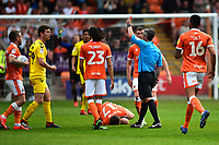 Fleetwood Town's Nathan Sheron is shown a red card by Referee Darren Bond<br /> <br /> Photographer Richard Martin-Roberts/CameraSport<br /> <br /> The EFL Sky Bet League One - Blackpool v Fleetwood Town - Monday 22nd April 2019 - Bloomfield Road - Blackpool<br /> <br /> World Copyright © 2019 CameraSport. All rights reserved. 43 Linden Ave. Countesthorpe. Leicester. England. LE8 5PG - Tel: +44 (0) 116 277 4147 - admin@camerasport.com - www.camerasport.com