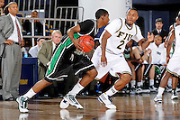 6 February 2010:  FIU's Stephon Weaver (2) defends the ball in the second half as the North Texas Mean Green defeated the FIU Golden Panthers, 68-66, at the U.S. Century Bank Arena in Miami, Florida.