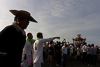 Mikoshi are carried into the sea during the Hamaorisai Matsuri that takes place on Southern Beach in Chigasaki, near Tokyo, Kanagawa, Japan Monday July 18th 2011. The festivals marks the celebration of Marine Day and the rescuing of a divine image that was washed ashore in the area. Over thirty Mikoshi or portable shrines are carried through the night from surrounding shrines to arrive on the beach for sunrise. There they are blessed and then carried into the surf to purify them.