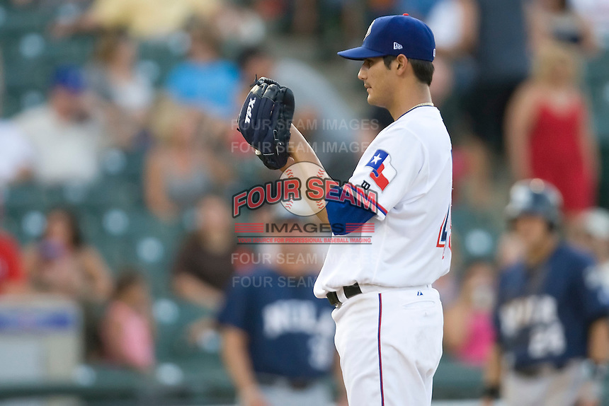Round Rock Express pitcher Martin Perez #45 looks n for the catchers sign during a game against the New Orleans Zephyrs at the Dell Diamond on July 21, 2011 in Round Rock, Texas.  New Orleans defeated Round Rock 7-4.  (Andrew Woolley/Four Seam Images)