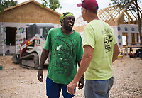 NWA Democrat-Gazette/CHARLIE KAIJO (From left) Asee Mason of Eureka laughs with Dr. Dan Bell, Friday, June 8, 2018 on Passion Play Road, across the street from the Washington Regional clinic in Eureka Springs. <br /><br />Eight tiny houses are being built in Eureka Springs, which has a dearth of affordable housing. They're being constructed by 66 volunteers from 13 states with World Mission Builders. They began work on Monday (June 4) and should finish most of the construction by the end of next week (June 15). Then local volunteers will finish out the interiors and put shingles on the roofs. The first eight houses are part of what will be called ECHO Village. Plans are to eventually have 26 houses in the village. It's a project of Eureka Christian Health Outreach, which bought 10 acres for the village. The same group started ECHO Clinic in Eureka Springs in 2005. It provides free medical care to the uninsured and people on a low income.