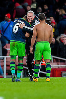 Ashley Williams of Swansea City  and Alan Curtis, First-team coach of Swansea City celebrate during the Barclays Premier League match between Arsenal and Swansea City at the Emirates Stadium, London, UK, Wednesday 02 March 2016