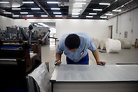 "A press technician checks the quality of a press plate for an English-language Bible in the Amity Printing Company's new printing facility in Nanjing, China....On May 18, 2008, the Amity Printing Company in Nanjing, Jiangsu Province, China, inaugurated its new printing facility in southern Nanjing.  The facility doubles the printing capacity of the company, now up to 12 million Bibles produced in a year, making Amity Printing Company the largest producer of Bibles in the world.  The company, in cooperation with the international organization the United Bible Societies, produces Bibles for both domestic Chinese use and international distribution.  The company's Bibles are printed in Chinese and many other languages.  Within China, the Bibles are distributed both to registered and unregistered Christians who worship in illegal ""house churches."""