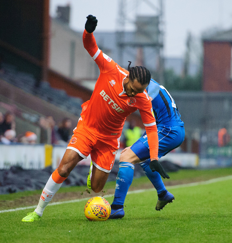 Blackpool's Nathan Delfouneso vies for possession with Rochdale's Matt Done<br /> <br /> Photographer Chris Vaughan/CameraSport<br /> <br /> The EFL Sky Bet League One - Rochdale v Blackpool - Wednesday 26th December 2018 - Spotland Stadium - Rochdale<br /> <br /> World Copyright © 2018 CameraSport. All rights reserved. 43 Linden Ave. Countesthorpe. Leicester. England. LE8 5PG - Tel: +44 (0) 116 277 4147 - admin@camerasport.com - www.camerasport.com