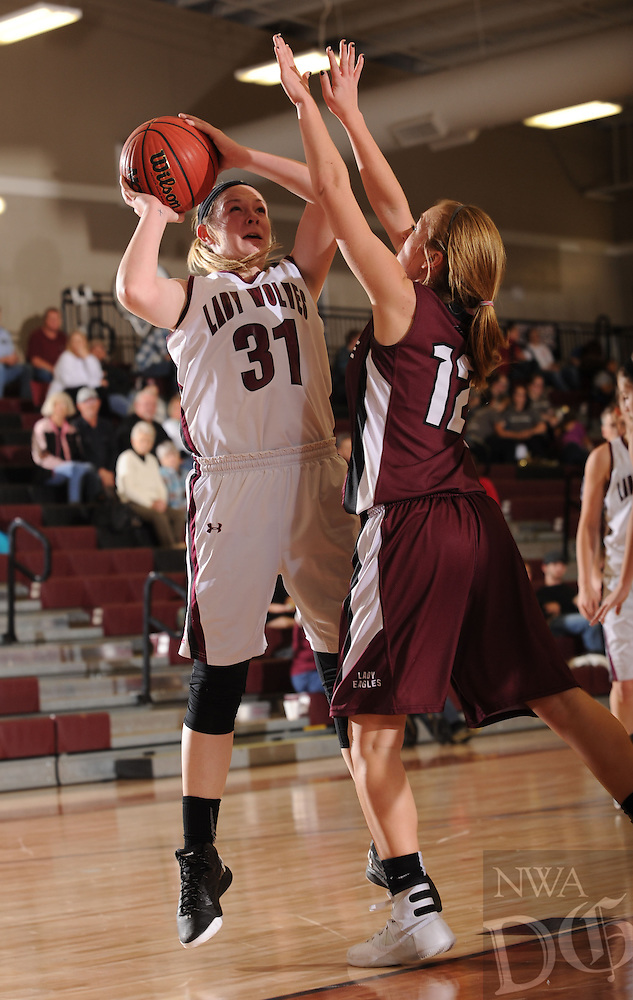NWA Democrat-Gazette/ANDY SHUPE<br /> Kendra Cummings (31) of Lincoln puts up a shot over Gentry Gosvener of Huntsville Friday, Jan. 8, 2016, during the first half of play in Lincoln. Visit nwadg.com/photos to see more photographs from the game.