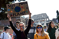 Banner: save your planet<br /> Rome March 15th 2019. Colosseo e Piazza Venezia. Fridays for Future Climate Strike in Rome, to answer the call of Greta Thunberg, the Swedish 15 year old who is cutting class to fight the climate crisis.<br /> Foto Samantha Zucchi Insidefoto