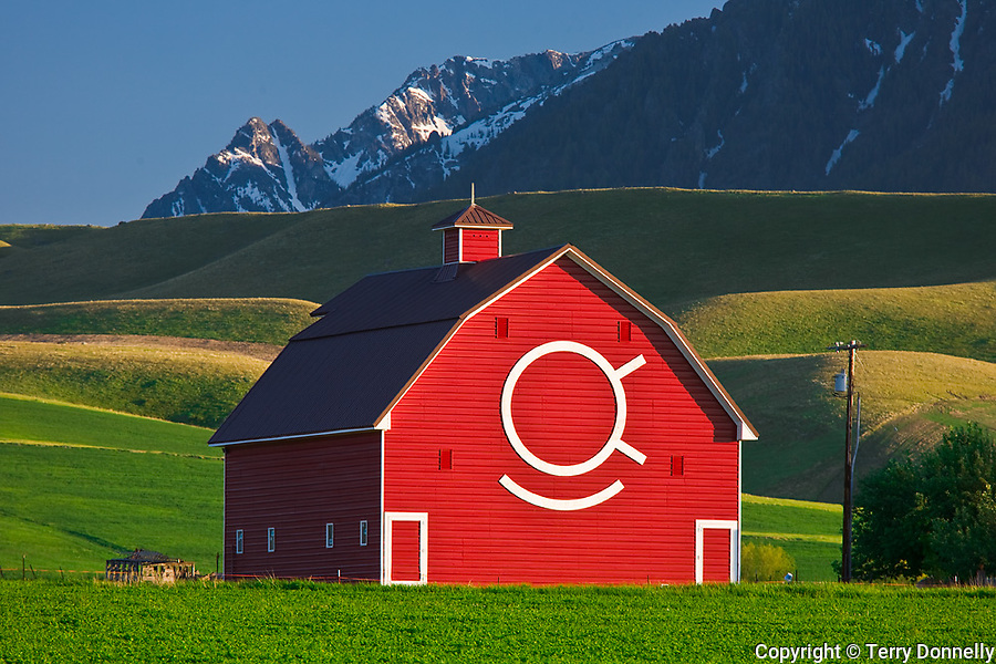 Wallowa County, OR   <br /> Red Brennan barn of the OK Quarter Circle ranch beneath the snowy peaks of the Wallowa mountains near Joseph