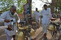 Cycling milkmen gather on the fringe of Bundi city from their village outposts to trade milk with local, door-to-door milkmen.