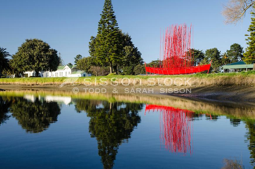 Red boat (waka?) sculpture on Waikanae creek. Gisborne, North Island New Zealand.