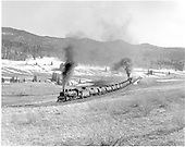 D&amp;RGW #498 leading eastbound tank train with two engines passing Lobo Lodge on its way to Cumbres.<br /> D&amp;RGW  Lobo Lodge, NM