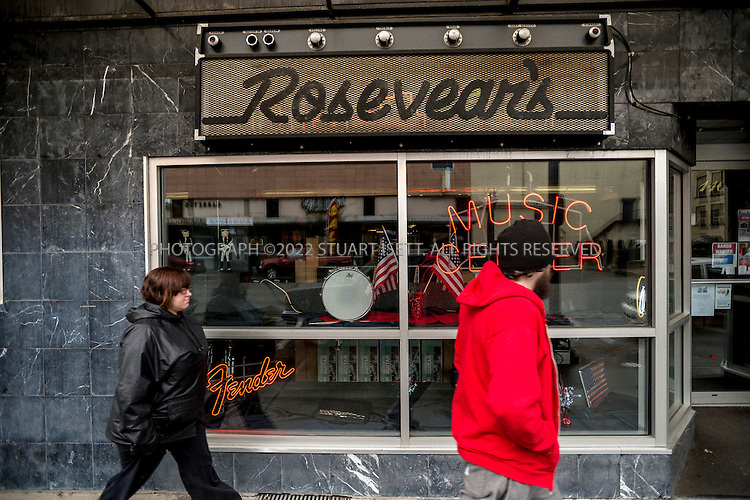 2/20/2014&mdash;Aberdeen, WA, USA<br /> <br /> Rosevear's Music Center at 211 E. Wishkah Street in Aberdeen, WA.  In 1981 for his fourteenth birthday, Kurt Cobain's uncle bought him a cheap electric guitar from the store. <br /> <br /> <br /> Aberdeen, located in Grays Harbor County, near the Washington State coast,  is the birth place of rock legend Kurt Cobain, lead singer of Nirvana. Aberdeen and the neighboring town of Hoquiam, have had a difficult relationship with Cobain&rsquo;s legacy, with his drug use and suicide causing many in the community to believe he should not be honored. In recent years though, as the 20th anniversary of Cobain&rsquo;s death approaches and Nirvana is set to join the Rock and Roll Hall of Fame, a steady stream of tourists and travelers are coming to the town to see Cobain&rsquo;s childhood home and other sights. Many in Aberdeen &ndash; a place Cobain once mocked as &ldquo;Twin Peaks without the excitement&rdquo; &ndash;  are now embracing him and the city held its first annual Kurt Cobain Day on Thursday, February 20th, 2014.<br /> <br /> Aberdeen though, has fallen on hard times. With the slow death of the logging and fishing industries, its downtown is filled with abandoned shops, storefront churches and a steady stream of drug addicts, homeless kids and prostitutes. Most cars pass through the city&rsquo;s main street, Wishkah Street, without stopping, heading to resort hotels and vacation homes on the Washington coast. Unemployment is high, many homes are falling down or abandoned.<br /> <br /> Photograph by Stuart Isett<br /> &copy;2014 Stuart Isett. All rights reserved.