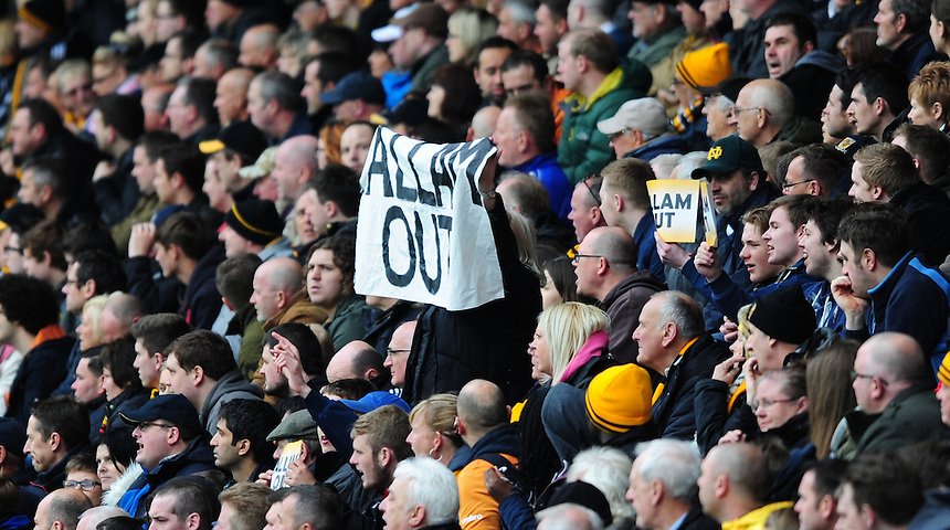 Hull City fans hold up 'Allam Out' banners during the first half<br /> <br /> Photographer: Chris Vaughan/CameraSport<br /> <br /> Football - Barclays Premiership - Hull City v Burnley - Saturday 9th May 2015 - Kingston Communications Stadium - Hull<br /> <br /> &copy; CameraSport - 43 Linden Ave. Countesthorpe. Leicester. England. LE8 5PG - Tel: +44 (0) 116 277 4147 - admin@camerasport.com - www.camerasport.com