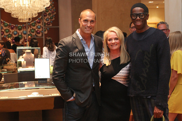 Fashion designer Pamella Roland (center), poses with photographer Nigel Barker (left); and runway coach Miss J Alexander, during the Pamella Roland Resort 2017 collection fashion presentation at Bvlgari located at 4 West 57 Street in New York City, on June 8, 2018.