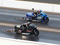 Sep 4, 2017; Clermont, IN, USA; NHRA pro stock motorcycle rider Karen Stoffer (near) alongside L.E. Tonglet during the US Nationals at Lucas Oil Raceway. Mandatory Credit: Mark J. Rebilas-USA TODAY Sports