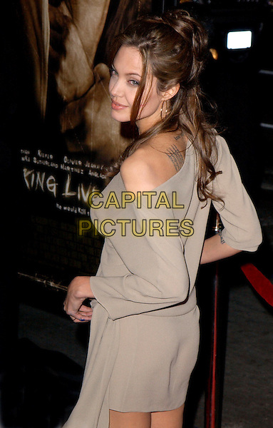 ANGELINA JOLIE.World Premiere of Taking Lives held at The Grauman's Chinese Theatre in Hollywood, California .16 March 2004.*UK Sales Only*.half length, half-length, off the shoulder, tattoo.www.capitalpictures.com.sales@capitalpictures.com.©Capital Pictures.