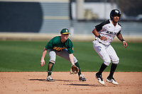 Siena Saints shortstop Devan Kruzinski (12) holds Brandon Hernandez (7) on during a game against the UCF Knights on February 17, 2019 at John Euliano Park in Orlando, Florida.  UCF defeated Siena 7-1.  (Mike Janes/Four Seam Images)