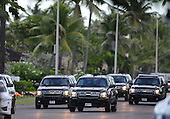 United States President Barack Obama's motorcade leaves his Kailuana Place residence on his way to his morning workout at Marine Corps Base Hawaii. Kailua. Hawaii, December 29, 2013.<br /> Credit: Cory Lum / Pool via CNP