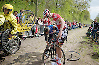 Kenny Dehaes (BEL/Lotto-Belisol) punctured halfway down the Trouée d'Arenberg / Bois de Wallers-Arenberg, which left him stranded for minutes because of trying non-campatible wheels from another team, while the Mavic assist motorbike flies by with the right wheels in hand without neither noticing<br /> <br /> <br /> <br /> before help arrived and robbed him of any chance regaining the breakaway he was in.<br /> <br /> Paris - Roubaux 2014
