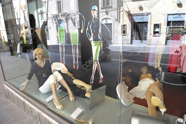 In the centre of L'Aquila, in Abruzzo, struck by a brutal earthquake in April, mannequins which fell over during the shock lay on the ground in a shop in the evacuated old centre of the city. May 22, 2009
