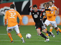 D.C. United forward Chris Pontius (13) goes against Houston Dynamo defender Bobby Boswell (32) D.C. United defeated The Houston Dynamo 3-2 at RFK Stadium, Saturday April 28, 2012.