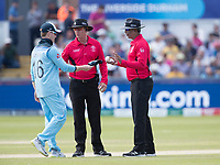 The standing umpires have a chat with Eoin Morgan (England) in relation to throwing the ball in on the bounce during England vs New Zealand, ICC World Cup Cricket at The Riverside Ground on 3rd July 2019