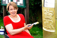 Stoke Mandeville, Bucks - Tanni Grey Thompson, 11 time Paralympics gold medallist, painted a post box gold to mark the start of the Paralympic Games, Stoke Mandeville, Bucks - August 28th 2012..Photo by Ross Stratton.