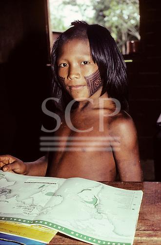 A-ukre village, Brazil. Pidjuri, a Kayapo boy, studying geography in the school; Xingu Indigenous Area, Para state.
