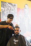 "Quik the Barber shaves Ekom Essien's hair at Graffitis SWAG Shop in South Atlanta, Georgia, July 25, 2013. Ekom said he always gets the same cut but ""maybe I'll venture out one day."""