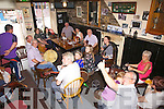 Sessions in the Anchor Bar Cahersiveen at the Fleadh on Sunday musicians seated l-r; Kevin Larkin, Paud Collins, Margaret O'Shea, Gráine O'Shea, Peter Mularkey, Rosaleen Mularkey, Fionán Casey, Selena O'Connell, Ellen Lynch, Caití O'Sullivan & Ritchie MacCarthy.