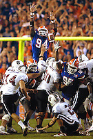 Florida defensive end #94 Jarvis Moss leaps high into the air to block the South Carolina field goal attempt on the final play of the game to preserve the Gators 17-16 victory over the Gamecocks Saturday November 11, 2006 in at Ben Hill Griffin Stadium in Gainesville, Fl. (The Florida Times-Union, Rick Wilson)