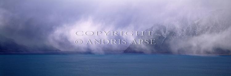 Mist and fog over Lake Hawea. Otago Region. New Zealand.