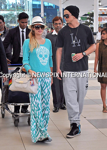 """03.12.2012; Mumbai, India: PARIS HILTON AND RIVER VIIPERI.arrive at Mumbai Airport, after spending the weekend in Goa..The American heiress and socialite took to the catwalk and acted as DJ at the closing of the annual Fashion Show held on Candolim Beach, Goa.Mandatory Photo Credit: ©Bhayani/NEWSPIX INTERNATIONAL..**ALL FEES PAYABLE TO: """"NEWSPIX INTERNATIONAL""""**..PHOTO CREDIT MANDATORY!!: NEWSPIX INTERNATIONAL(Failure to credit will incur a surcharge of 100% of reproduction fees)..IMMEDIATE CONFIRMATION OF USAGE REQUIRED:.Newspix International, 31 Chinnery Hill, Bishop's Stortford, ENGLAND CM23 3PS.Tel:+441279 324672  ; Fax: +441279656877.Mobile:  0777568 1153.e-mail: info@newspixinternational.co.uk"""
