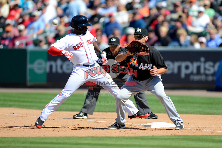 Miami Marlins first baseman Casey Kotchman #18 takes a throw as Jackie Bradley Jr gets back to first during a Spring Training game against the Boston Red Sox at JetBlue Park on March 27, 2013 in Fort Myers, Florida.  Miami defeated Boston 5-1.  (Mike Janes/Four Seam Images)