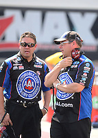 Sept. 15, 2012; Concord, NC, USA: NHRA Crew chief Jim Prock (right) with crew member for funny car driver Robert Hight during qualifying for the O'Reilly Auto Parts Nationals at zMax Dragway. Mandatory Credit: Mark J. Rebilas-