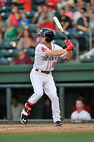 Center fielder Andrew Benintendi (2) of the Greenville Drive bats in a game against the Greensboro Grasshoppers on Thursday, August 27, 2015, at Fluor Field at the West End in Greenville, South Carolina. Benintendi is a first-round pick of the Boston Red Sox in the 2015 First-Year Player Draft out of the University of Arkansas. Greenville won, 10-2. (Tom Priddy/Four Seam Images)