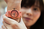 An exhibitor wears a wrist watch made of bamboo at the Tokyo Gift Show exhibition on September 7, 2016, Tokyo, Japan. The 82nd Tokyo International Gift Show Autumn 2016 exhibition introduced Japanese and international goods from 2,729 companies, 686 of which came from 19 different countries outside of Japan, over three days from September 7th to 9th at Tokyo Big Sight. (Photo by Rodrigo Reyes Marin/AFLO)