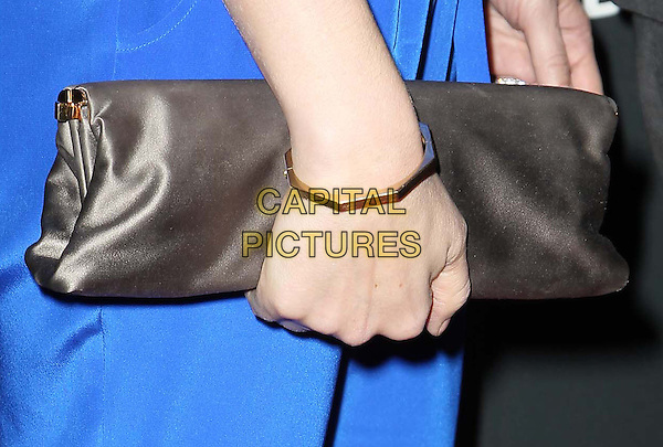 Stephanie March's hand .Delta Air Lines, the Official Airline of the GRAMMY Awards,celebrate LA's music industry Held At The Getty House, Los Angeles, California, USA, .7th February 2013..detail hand grey gray clutch bag gold bracelet .CAP/ADM/KB.©Kevan Brooks/AdMedia/Capital Pictures.
