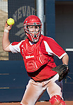 March 10, 2012:  Wisconsin Badgers catcher Maggie Strange throws to first against the Nevada Wolf Pack during their NCAA softball game played as part of the The Wolf Pack Classic at Christina M. Hixson Softball Park on Saturday in Reno, Nevada.