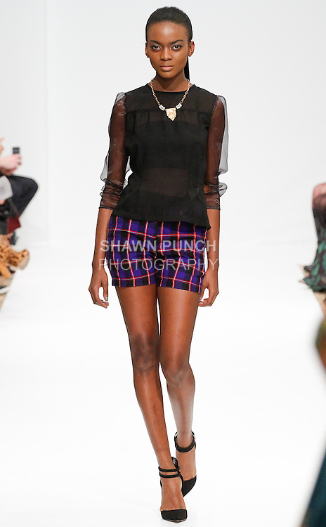 Model walks runway in an outfit from the Judith & James Fall Winter 2014 collection from Anna Taylor, for the Designer's Premier Fall 2014, during New York Fashion Week Fall 2014, February 9, 2014.