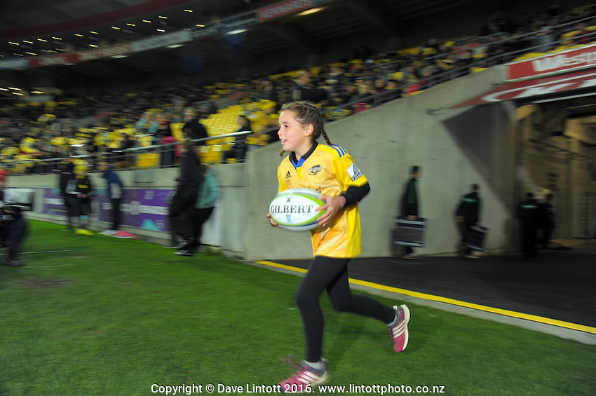 The matchball is carried out during the Super Rugby match between the Hurricanes and Blues at Westpac Stadium, Wellington, New Zealand on Saturday, 2 July 2016. Photo: Dave Lintott / lintottphoto.co.nz
