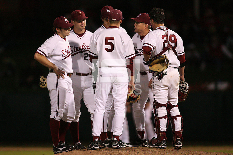 STANFORD, CA - FEBRUARY 20:  Head coach Mark Marquess (second from right) of the Stanford Cardinal during Stanford's season opener game against the Vanderbilt Commodores on February 20, 2009 at Sunken Diamond in Stanford, California.