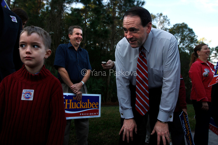 U.S. Presidential hopeful Mike Huckabee (R-AR) jokes around with five-year-old Luke Marks, from Tampa, Florida, by a polling site at the Westchase Swim and Tennis Center, where he stopped by to greet voters and potential supporters in Tampa, Florida, on Tuesday, January 29, 2008. (Photo by: Yana Paskova for The New York Times)..Assignment ID: 30055282S..                                 ...........