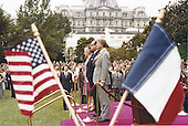 Framed by the flags of the United States of America and the Republic of France, US President Jimmy Carter and first lady Rosalynn Carter and Prime Minister Raymond Barre of France and his wife, Eve, stand at attention during the full honor arrival ceremony on the South Lawn of the White House in Washington, DC on September 15, 1977.  Prime Minister Barre is in Washington for two days of talks with top officials in the Carter Administration.<br /> Credit: Arnie Sachs / CNP