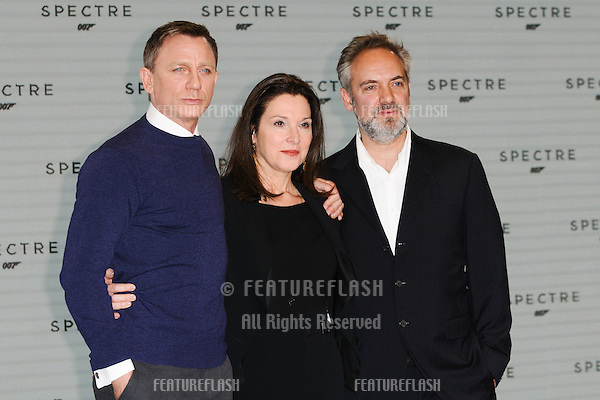 "Daniel Craig, Barbara Broccoli and Sam Mendes at the announcement of the start of filming on the new James Bond movie ""Spectre"" at Pinewood Studios, London. 04/12/2014 Picture by: Steve Vas / Featureflash"